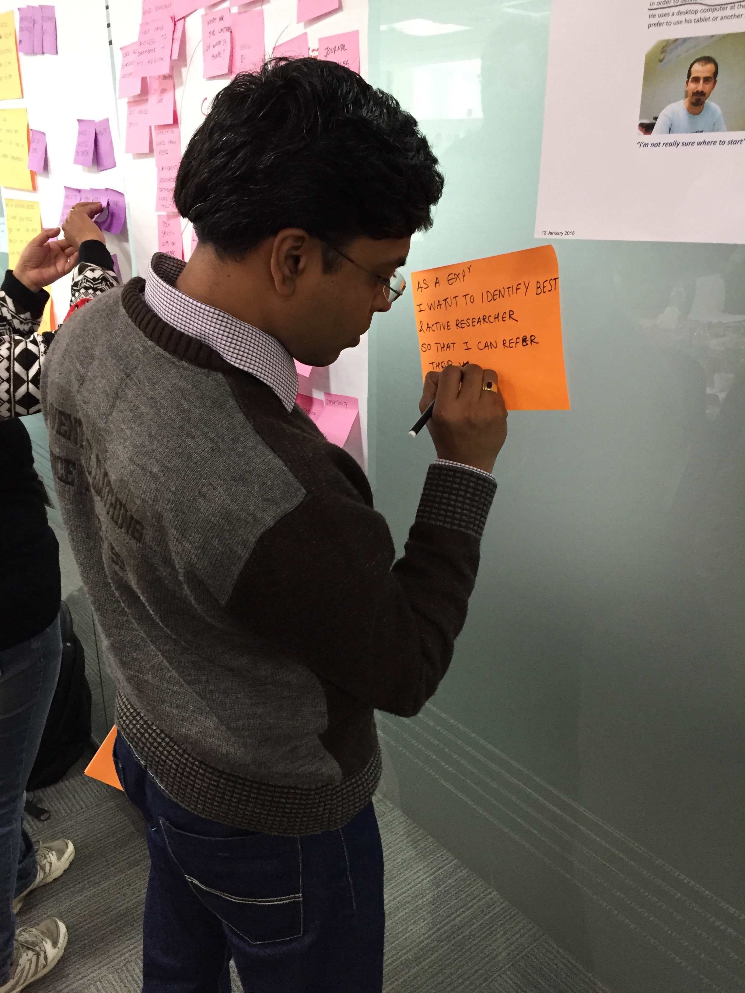 A member of our Pune production team, wiriting out user goals from the personas
